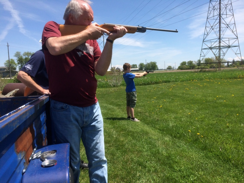 Grandad & Austin doing some plinking with pellet guns.